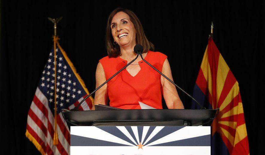 U.S. senatorial candidate and U.S. Rep. Martha McSally, R-Ariz., celebrates her primary election victory, Tuesday, Aug. 28, 2018, in Tempe, Ariz. McSally will face U.S. Rep. Krysten Sinema, D-Ariz., in the November election as they seek the seat of retiring U.S. Sen. Jeff Flake, R-Ariz. (AP Photo/Matt York)
