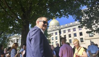 Former coal executive Don Blankenship waits outside the West Virginia Capitol on Wednesday, Aug. 29, 2018, after the Capitol was evacuated due to a fire alarm in Charleston, W.Va. The alarm interrupted a hearing for Blankenship in the state Supreme Court over whether he could be placed on the fall ballot in the U.S. Senate race. (AP Photo/John Raby)