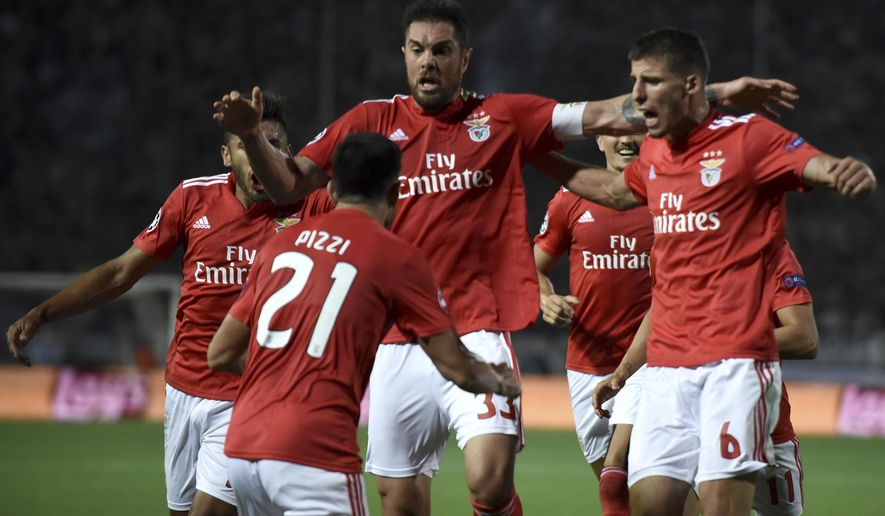 Benfica's players celebrate their sides first goal against PAOK during the Champions League playoffs, second leg, soccer match between PAOK and Benfica at theToumba stadium in the northern Greek port city of Thessaloniki, on Wednesday, Aug. 29, 2018. (AP Photo/Giannis Papanikos)