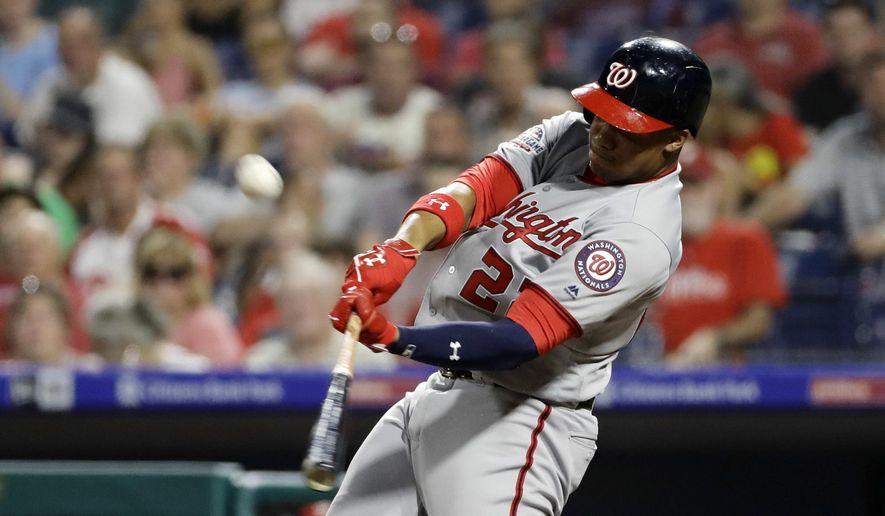 Washington Nationals' Juan Soto hits a two-run home run off Philadelphia Phillies starting pitcher Jake Arrieta during the third inning of a baseball game Wednesday, Aug. 29, 2018, in Philadelphia. (AP Photo/Matt Slocum)