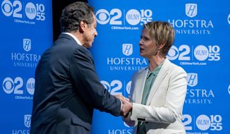 New York Gov. Andrew Cuomo, left, shakes hands with Democratic New York gubernatorial candidate Cynthia Nixon before their debate at Hofstra University in Hempstead, N.Y., Wednesday, Aug. 29, 2018. (AP Photo/Craig Ruttle, Pool)