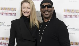 """FILE - In this Nov. 20, 2016, file photo, Paige Butcher, left, and Eddie Murphy attend """"SUBCONSCIOUS"""" by Bria Murphy Gallery Opening at Lace Gallery in Los Angeles. Murphy is going to be a father for the tenth time. The actor and comedian's publicist has issued a statement that Murphy and longtime girlfriend Butcher are expecting their second child in December. (Photo by Richard Shotwell/Invision/AP, File)"""