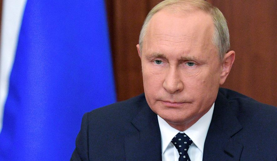 """Russian President Vladimir Putin makes an address on the state TV in the Kremlin in Moscow, Russia, Wednesday, Aug. 29, 2018. Putin in a televised address Wednesday said without raising the retirement age Russia's pension system """"would crack and eventually collapse."""" He offered concessions to the reform, saying that women's retirement age should increase from 55 to 60 years, lower than had proposed. (Alexei Druzhinin, Sputnik, Kremlin Pool Photo via AP)"""