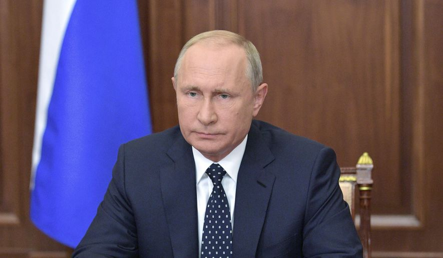 "Russian President Vladimir Putin makes an address on the state TV in the Kremlin in Moscow, Russia, Wednesday, Aug. 29, 2018. Putin in a televised address Wednesday said without raising the retirement age Russia's pension system ""would crack and eventually collapse."" He offered concessions to the reform, saying that women's retirement age should increase from 55 to 60 years, lower than had proposed. (Alexei Druzhinin, Sputnik, Kremlin Pool Photo via AP)"