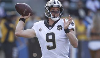 File- This Aug. 25, 2018, file photo shows New Orleans Saints quarterback Drew Brees throwing a pass during the first half of an NFL preseason football game against the Los Angeles Chargers in Carson, Calif. If the Saints make it as far as the NFC title game, their star quarterback will have just turned 40. But quarterbacks like Brees and New England's Tom Brady are trying to redefine QB longevity in this era of evolving training theories and NFL rules designed to protect quarterbacks, at least those who don't run much. (AP Photo/Jae C. Hong, File)