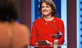 FILE - In this July 26, 2018, file photo, Republican U.S. Senate candidate Leah Vukmir stands at her podium during a debate with fellow candidate Kevin Nicholson in Milwaukee. Vukmir, who went on to won the GOP primary, faces Democratic Sen. Tammy Baldwin in the November election. (Tyger Williams/Milwaukee Journal-Sentinel via AP)