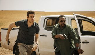 "This image released by Amazon shows John Krasinski, left, and Wendell Pierce in a scene from ""Tom Clancy's Jack Ryan."" (Jan Thijs/Amazon via AP)"