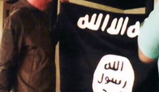 FILE - In this July 8, 2017 file image taken from FBI video and provided by the U.S. Attorney's Office in Hawaii on July 13, 2017, Army Sgt. 1st Class Ikaika Kang holds an Islamic State group flag after allegedly pledging allegiance to the terror group at a house in Honolulu. Kang is set to plead guilty Wednesday, Aug. 29, 2018, as charged in an indictment last year, defense attorney Birney Bervar said. He is agreeing to a 25-year sentence for charges that could have put him in prison for life. (FBI/U.S Attorney's Office, District of Hawaii via AP, File)