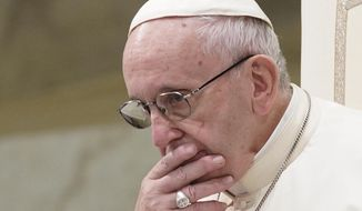 In this Aug. 22, 2018, file photo, Pope Francis is caught in pensive mood during his weekly general audience in the Pope Paul VI hall, at the Vatican. Archbishop Carlo Maria Vigano, with his 11-page testimony, have thrown Francis' 5-year papacy into crisis. (AP Photo/Andrew Medichini)