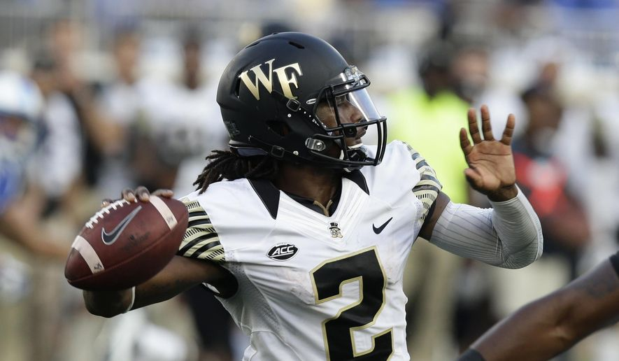 In this Sept. 10, 2016, file photo, Wake Forest quarterback Kendall Hinton (2) passes against Duke during the second half of an NCAA college football game in Durham, N.C. Wake Forest is trying to weather the early season suspension of Hinton, their presumed starting quarterback, while Tulane is brimming with optimism after showing steady progress during coach Willie Fritz's first two years. Both squads will learn more about where they stand when they open their seasons against one another at Tulane on Thursday night. (AP Photo/Gerry Broome, File) **FILE**