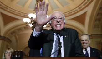 Sen. Bernie Sanders, I-Vt., center, speaks after a caucus luncheon, with Sen. Patty Murray, D-Wash., left, and Senate Minority Leader Chuck Schumer of N.Y., on Capitol Hill, Tuesday, Dec. 19, 2017 in Washington. (AP Photo/Alex Brandon)