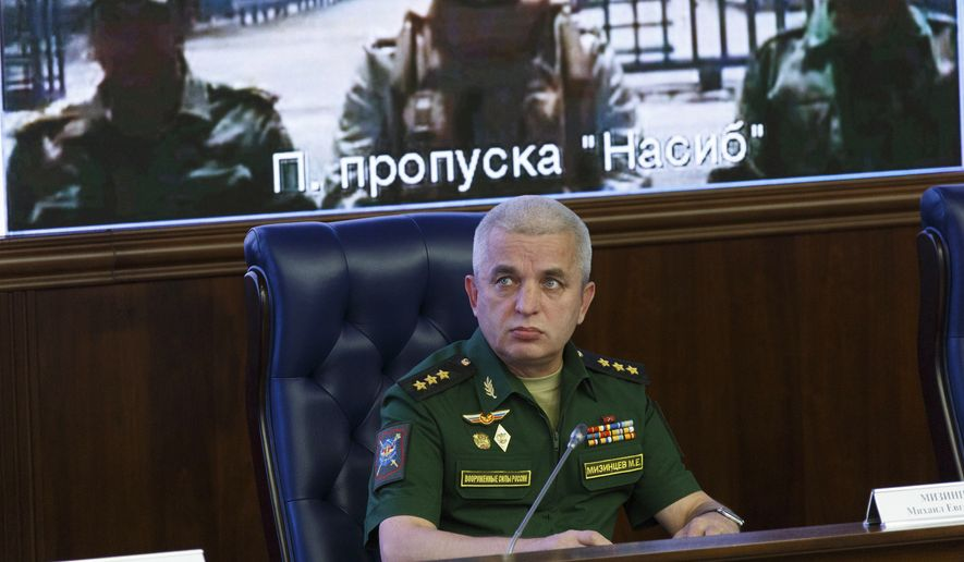 The head of Russia's National Defense Control Center, Col. Gen. Mikhail Mizintsev, speaks to the media during an inter-agency coordination headquarters meeting and video call between Moscow and Syria in Moscow, Thursday, Aug. 30, 2018. (Balashova Olga, Russian Defense Ministry Press Service via AP)