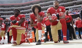 From left, San Francisco 49ers outside linebacker Eli Harold, quarterback Colin Kaepernick and safety Eric Reid kneel during the national anthem before an NFL football game against the Dallas Cowboys in Santa Clara, Calif.  (AP Photo/Marcio Jose Sanchez, File)