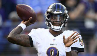 Baltimore Ravens quarterback Lamar Jackson warms up before a preseason NFL football game against the Washington Redskins, Thursday, Aug. 30, 2018, in Baltimore. (AP Photo/Nick Wass)