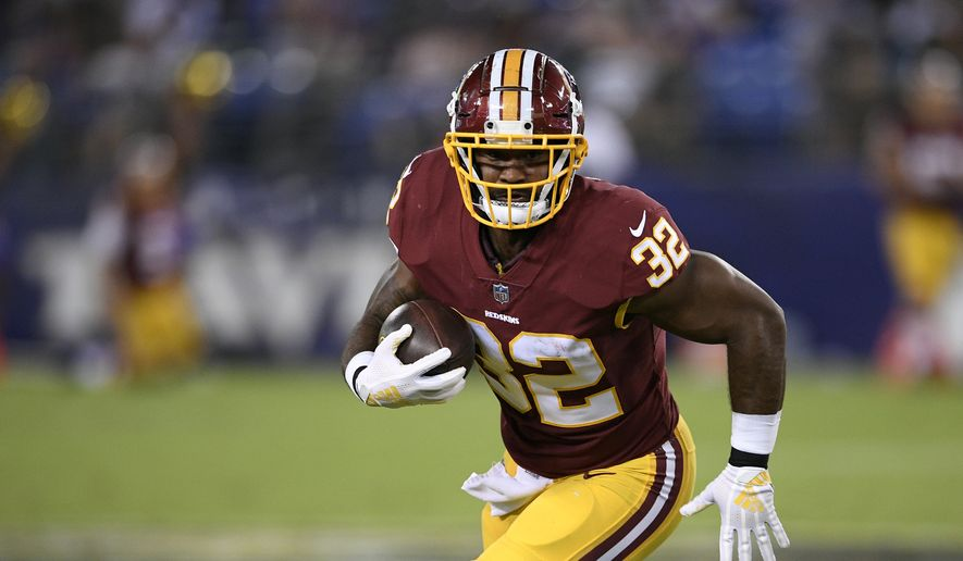 Washington Redskins running back Samaje Perine rushes the ball in the first half of a preseason NFL football game against the Baltimore Ravens, Thursday, Aug. 30, 2018, in Baltimore. (AP Photo/Nick Wass) ** FILE **