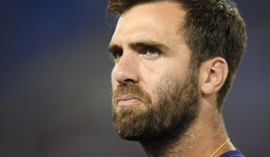 Baltimore Ravens quarterback Joe Flacco stands on the sideline in the second half of a preseason NFL football game against the Washington Redskins, Thursday, Aug. 30, 2018, in Baltimore. (AP Photo/Nick Wass)