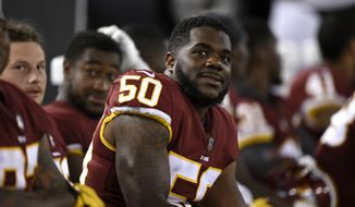 Washington Redskins linebacker Martrell Spaight sits on the sideline in the second half of a preseason NFL football game against the Baltimore Ravens, Thursday, Aug. 30, 2018, in Baltimore. (AP Photo/Gail Burton)