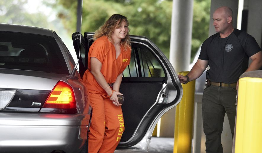In this Aug. 23, 2018, file photo, Reality Winner arrives at a courthouse in Augusta, Ga., after she pleaded guilty in June to copying a classified U.S. report and mailing it to an unidentified news organization. (Michael Holahan/The Augusta Chronicle via AP, File)