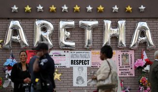 People gather outside New Bethel Baptist Church before a viewing for Aretha Franklin, Thursday, Aug. 30, 2018, in Detroit. Franklin died Aug. 16, 2018 of pancreatic cancer at the age of 76. (AP Photo/Jeff Roberson)
