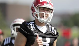 FILE - In this Aug. 3, 2018, file photo, Rutgers quarterback Artur Sitkowski works out during NCAA college football training camp, in Piscataway, N.J. In an earlier time, a true freshman starting quarterback wasn't necessarily unthinkable, but it certainly was an outlier. Not so much anymore. Three of the Big Ten's six new starters were in high school a year ago. (AP Photo/Julio Cortez, File)