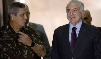 Gen. Walter Souza Braga Netto, left, and Brazils' President Michel Temer, arrive for an update on the federal security intervention in Rio de Janeiro, Brazil, Thursday, Aug.30, 2018. (AP Photo/Silvia Izquierdo)