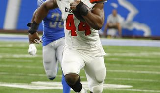 Cleveland Browns defensive end Nate Orchard (44) returns an interception for a 64-yard touchdown during the first half of an NFL football preseason game against the Detroit Lions, Thursday, Aug. 30, 2018, in Detroit. (AP Photo/Rick Osentoski)