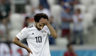 FILE - In this June 25, 2018, file photo, Egypt's Mohamed Salah reacts after Saudi Arabia's Salem Aldawsari scored his side' second goal during the group A match between Saudi Arabia and Egypt at the 2018 soccer World Cup at the Volgograd Arena in Volgograd, Russia. Emboldened by his global star power, Salah has said out loud what many of his Egyptian teammates have been saying in private for weeks: Failure by the national federation to enforce discipline and stop meddling by sponsors was mostly to blame for the Pharaohs' miserable World Cup run in Russia. (AP Photo/Andrew Medichini, File)