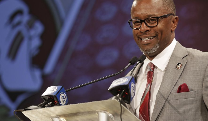 FILE - In this July 19, 2018, file photo, Florida State head coach Willie Taggart answers a question during a news conference at the Atlantic Coast Conference NCAA college football media day in Charlotte, N.C. Taggart grew up a Florida State fan and now that the 42-year old has his dream job of coaching the Seminoles. He is only the third Florida State coach since 1976, joining Bobby Bowden and Jimbo Fisher, who both won national titles.  (AP Photo/Chuck Burton, File)