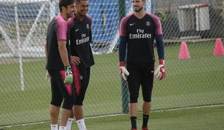 PSG's goalkeepers Gianluigi Buffon, left, Alphonse Areola, center4, and Kevin Trapp attend a training session at the club training center in Saint Germain en Laye, west of Paris, Friday, Aug.24, 2018. Paris Saint Germain will play Angers Saturday in a French League One match. (AP Photo/Michel Euler)