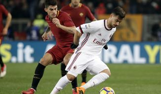 """FILE- in this. Sunday, Feb. 25, 2018 file photo, AC Milan's Suso, right, and Roma's Diego Perotti vie for the ball during a Serie A soccer match between Roma and AC Milan, at the Rome Olympic stadium. A """"Made in USA"""" matchup. The """"American derby."""" Italian media are promoting Friday's match between AC Milan and Roma at the San Siro stadium as the first meeting of two American-owned clubs in Serie A. (AP Photo/Alessandra Tarantino, File)"""