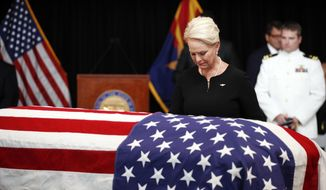 Cindy McCain, wife of, Sen. John McCain, R-Ariz., looks at the casket during a memorial service at the Arizona Capitol on Wednesday, Aug. 29, 2018, in Phoenix. (AP Photo/Jae C. Hong, Pool)