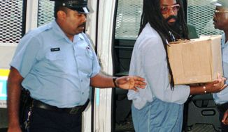 FILE - In this July 25, 1995 file photo, Mumia Abu-Jamal, convicted of killing a policeman, arrives at Philadelphia's City Hall. Former death row inmate Abu-Jamal is back in court Thursday, Aug. 30, 2018, requesting that his failed appeals attempts be vacated, so he can once again appeal his case. The former Black Panther spent 29 years on death row following his conviction in the 1981 murder of Philadelphia police Officer Daniel Faulkner. (AP Photo/Nanine Hartzenbusch, File)