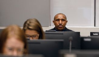 Bosco Ntaganda, a Congo militia leader, sits in the courtroom of the International Criminal Court (ICC) during the closing statements of his trial in The Hague, Netherlands, Tuesday Aug. 28, 2018. Ntaganda is facing charges of war crimes and crimes against humanity allegedly committed in the eastern Ituri region of Congo from 2002-2003. (Bas Czerwinski/Pool via AP)