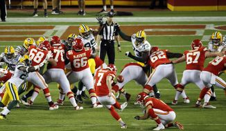 Kansas City Chiefs' Harrison Butker (7) kicks an extra point during the second half of an NFL preseason football game against the Green Bay Packers in Kansas City, Mo., Thursday, Aug. 30, 2018. (AP Photo/Charlie Riedel)