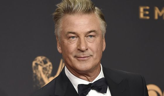 "In this Sept. 17, 2017, file photo, Alec Baldwin poses in the press room with the award for outstanding supporting actor in a comedy series for ""Saturday Night Live"" at the 69th Primetime Emmy Awards in Los Angeles. (Photo by Jordan Strauss/Invision/AP, File)"