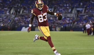 Washington Redskins wide receiver Brian Quick reacts as he scores a touchdown in the first half of a preseason NFL football game against the Baltimore Ravens, Thursday, Aug. 30, 2018, in Baltimore. (AP Photo/Gail Burton) ** FILE **