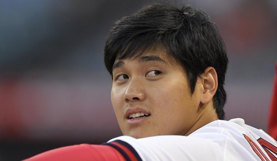Los Angeles Angels' Shohei Ohtani, of Japan, sits in the dugout prior to a baseball game against the Colorado Rockies, Monday, Aug. 27, 2018, in Anaheim, Calif. (AP Photo/Mark J. Terrill)