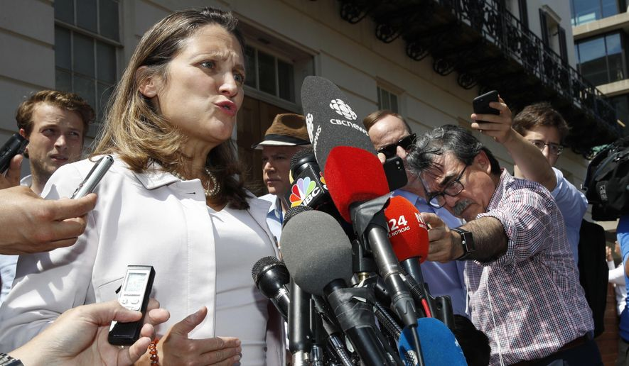 Canada's Foreign Affairs Minister Chrystia Freeland speaks to the media as she comments during a break in trade talks at the Office of the United States Trade Representative, Thursday, Aug. 30, 2018, in Washington. (AP Photo/Jacquelyn Martin)