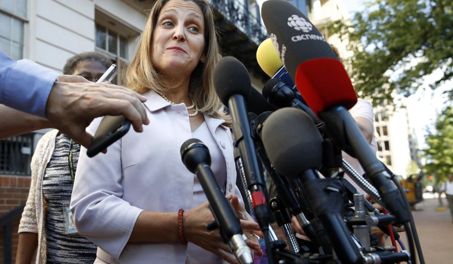 Canada's Foreign Affairs Minister Chrystia Freeland speaks to the media as she arrives for trade talks at the Office of the United States Trade Representative, Thursday, Aug. 30, 2018, in Washington. (AP Photo/Jacquelyn Martin)