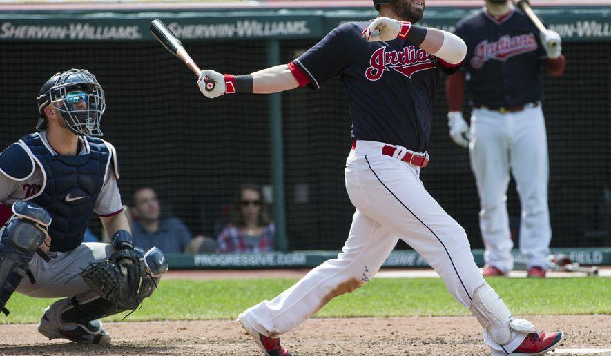 Cleveland Indians' Jason Kipnis watches his three-run home run off Minnesota Twins relief pitcher Alan Busenitz as Twins catcher Mitch Garver looks on during the sixth inning of a baseball game in Cleveland, Thursday, Aug. 30, 2018. (AP Photo/Phil Long)