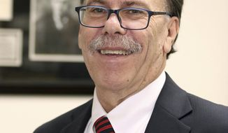 """In this photo taken March 17, 2016, Clark County Public Defender Phil Kohn is photographed in downtown Las Vegas. Officials say Kohn, the top administrator of the public defender's office in Las Vegas, received unspecified discipline following a sexual harassment investigation. Clark County Manager Yolanda King confirmed in a statement Thursday, Aug. 30, 2018, that Kohn was found to have made """"inappropriate comments of a sexual nature in the workplace and engaged in inappropriate physical behavior toward employees."""" (Ronda Churchill/Las Vegas Review-Journal via AP)"""