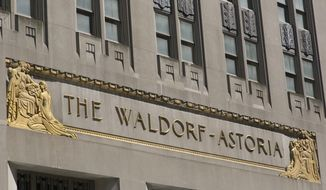 FILE - In this May 9, 2018 file photo, the exterior of the Waldorf-Astoria hotel is shown in New York. Hilton is set to begin rebranding the Mandarin Oriental hotel on the Las Vegas Strip as a Waldorf Astoria. The transition that will start Friday, Aug. 31, 2018, at the 389-room, casino-less property will lead to renovations and mark the debut of another luxury brand on the Strip. (AP Photo/Mark Lennihan, File)
