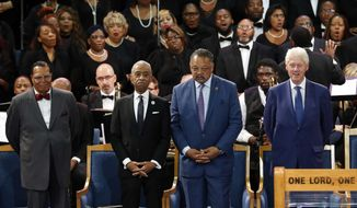 Louis Farrakhan, from left, the Rev. Al Sharpton, the Rev. Jesse Jackson and former President Bill Clinton attend the funeral service for Aretha Franklin at Greater Grace Temple, Friday, Aug. 31, 2018, in Detroit. Franklin died Aug. 16, 2018, of pancreatic cancer at the age of 76. (AP Photo/Paul Sancya)