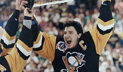 Mario Lemieux, Pittsburgh Penguins (1984-1997, 2000-2006) Pittsburgh Penguins' Mario Lemieux holds up the Stanley Cup trophy the Penguins won beating the Minnesota North Stars 8-0 to win the Stanley Cup in Bloomington, Minn., May 26, 1991, to win the best of seven series 4-2. Lemieux was named the Most Valuable Player in the series. (AP Photo/Bill Waugh)