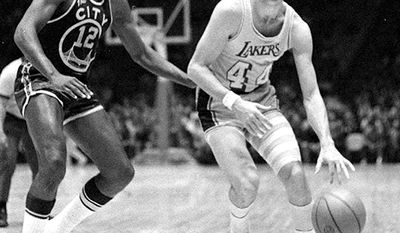 Jerry West, Los Angeles Lakers (1976-1979) Los Angeles Lakers guard Jerry West drives the ball past San Francisco Warriors' Ron Williams March 11, 1970 in Los Angeles. West, part of seven NBA championships in four decades as a player, coach and executive with the Lakers, will retire Monday, August 7, 2000. The Los Angeles Times, citing unidentified league and team sources, said West, now executive vice president, will continue as a consultant. (AP Photo)