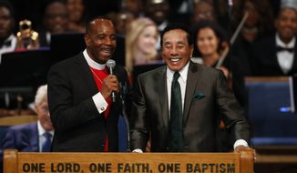 Bishop Charles H. Ellis, III, pastor of Greater Grace Temple, left, laughs with Smokey Robinson during the funeral service for Aretha Franklin at Greater Grace Temple, Friday, Aug. 31, 2018, in Detroit. Franklin died Aug. 16, 2018 of pancreatic cancer at the age of 76. (AP Photo/Paul Sancya)