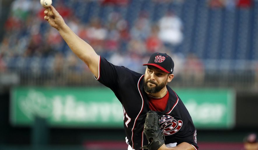 Washington Nationals starting pitcher Tanner Roark throws during the first inning of a baseball game against the Milwaukee Brewers at Nationals Park, Friday, Aug. 31, 2018, in Washington. (AP Photo/Alex Brandon)