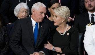 Cindy McCain, wife of, Sen. John McCain, R-Ariz., right, talks with Vice President Mike Pence, left, after he speaks at a ceremony for John McCain as he lies in state in the Rotunda of the U.S. Capitol, Friday, Aug. 31, 2018, in Washington. (AP Photo/Andrew Harnik, Pool)