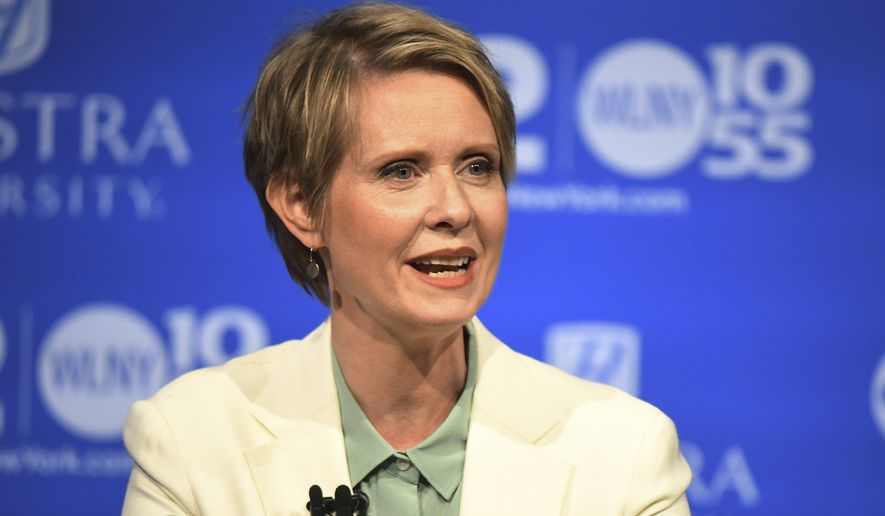 In the Aug. 29, 2018, file photo, Cynthia Nixon, Democratic hopeful for the New York Governor's Office, speaks at the Democratic gubernatorial primary at Hofstra University in Hempstead, N.Y. Nixon is taking her campaign for governor upstate as the Democratic primary nears, making stops in Rochester, Syracuse, Ithaca, Schenectady and Saratoga Springs on Friday, Aug. 31, and throughout the long Labor Day weekend. (J. Conrad Williams Jr./Newsday via AP, Pool)