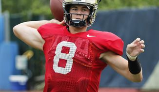 """FILE - In this Aug. 9, 2018, file photo, Pittsburgh quarterback Kenny Pickett (8) passes in a drill during an NCAA college football practice in Pittsburgh. Pittsburgh head coach Pat Narduzzi says sophomore quarterback Kenny Pickett doesn't have to think he's """"Kenny Perfect."""" Either way, Pickett will be the focal point for Pitt when the Panthers open the 2018 season on Saturday against Albany. (AP Photo/Keith Srakocic, File)"""